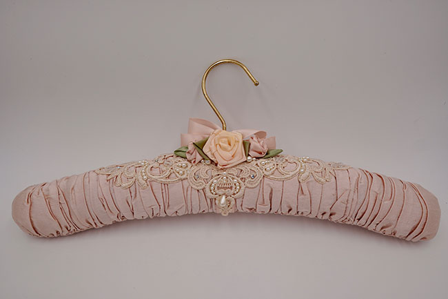 Freestanding lace on coat hanger