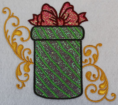 Embroidery Design: Christmas present with swirls 6.68w X 5.96h