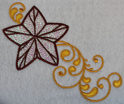 Embroidery Design: Christmas star with swirls 5.2w X 4.38h