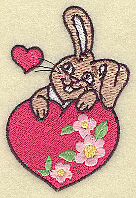Embroidery Design: Bunny resting on floral heart 2.60w X 3.86h