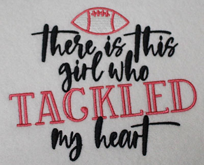 Embroidery Design: Girl Tackled Heart Lg 5.36w X 4.51h