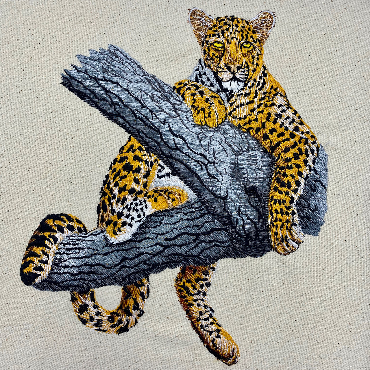 leopard in tree embroidery design