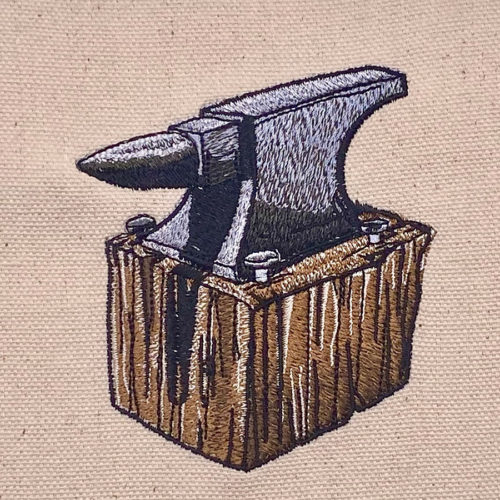anivil on wood block embroidery design