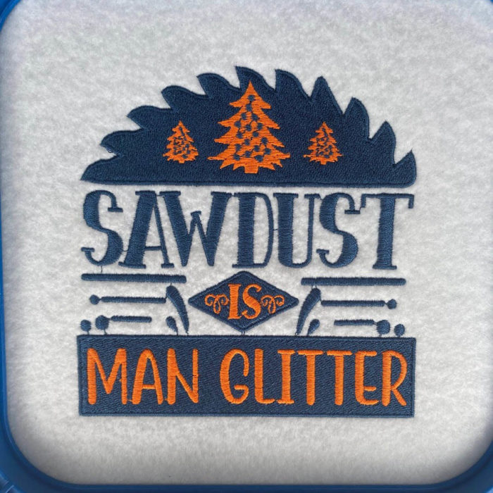 Sawdust in man glitter embroidery design